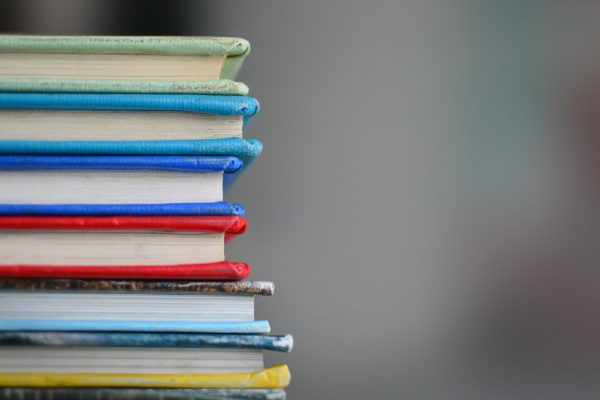 Colourful books stacked